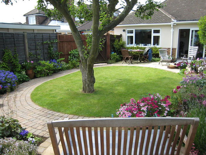 Garden Design In Bedfordshire Oval Lawn With Curved Path, Patio Laid In  Sandstone, Borders And Apple Tree, ...