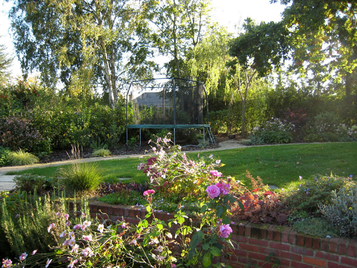 the trampoline accessible but tucked away - Garden Design With Trampoline