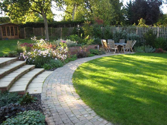 Good Harpenden Garden Design In Autumn Patio, Lawn, Path, And Steps To Upper  Garden. Planting Includes Roses ...